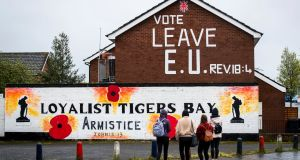 Loyalist Tigers Bay mural and Vote Leave EU with the biblical reference to Revelation 18:4 on the gable wall of a property in north Belfast, on Wednesday.  Photograph: Liam McBurney/PA Wire