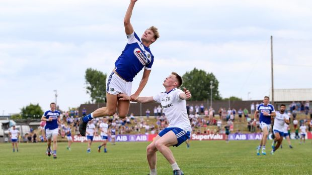 Shane Nerney of Laois in action against Monaghan's Ryan McAnespie during last summer's qualifier clash at Páirc Tailteann in Navan. Photograph: Tommy Dickson/Inpho