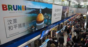"An advertising billboard of the Royal Brunei Airlines promoting Brunei as ""abode of peace"" at a transport station in Taiwan, on Wednesday. Photograph:  David Chang/EPA"