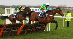 Champ ridden by jockey Barry Geraghty on his way to winning the Doom Bar Sefton Novices' Hurdle on Friday at Aintree. Photograph: PA