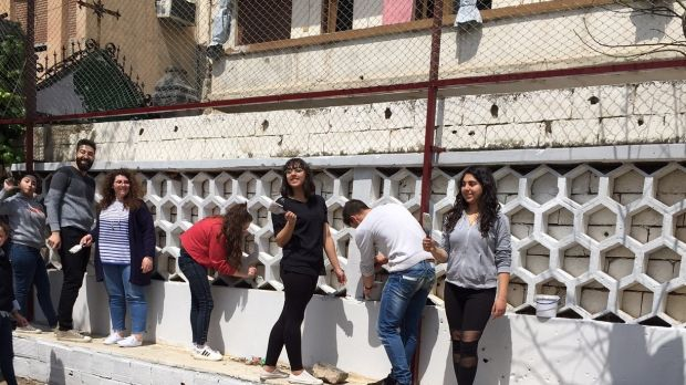 Young people in Homs preparing for the Mass and lunch to commemorate murdered Jesuit priest Fr Frans van der Lugt. Photograph: Michael Jansen