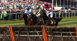 If The Cap Fits ridden by jockey Sean Bowen (centre) on the way to winning the Ryanair Stayers' Hurdle at Aintree from Roksana (left) and Apple's Jade (right). Photograph:  Nigel French/PA Wire