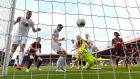 Chris Wood scores for Burnley at the Vitality Stadium. Photograph: Justin Setterfield/Getty Images