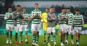 Celtic players thank the home fans after their draw with Livingston at Celtic Park. Photograph: pA