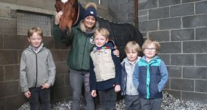 Louise Magee with her four children and Tiger Roll. Photograph: John Grossick/The Jockey Club.