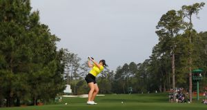 Olivia Mehaffey  drives from the third tee  f during the final round of the Augusta National Women's Amateur at Augusta National in Augusta, Georgia. Photograph/Kevin C. Cox/Getty Images