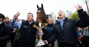 Tiger Roll pictured with trainer Gordon Elliot, groom Louise Magee  and owner Micheal O'Leary. Photograph: Tom Honan