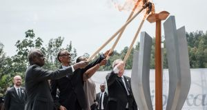 From left,  African Union chief Moussa Faki, Rwanda president Paul Kagame, his wife, Jeannette,  and European Commission president Jean-Claude Juncker light a remembrance flame for the 25th Commemoration  at the Kigali Genocide Memorial in  Rwanda. Photograph:   Yasuyoshi Chiba / AFP