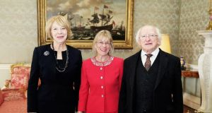 Sally O'Neill pictured at Áras An Uachtarain in March 2015 with President Michael D Higgins and Sabina Higgins. Photograph: Maxwell's