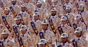 Iranian Revolutionary Guard soldiers march during a military parade. Photograph: Abedin Taherkenareh/EPA