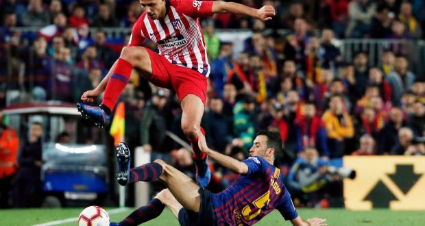 ead671f2234 Barcelona s Sergio Busquets slides in to tackle Atletico Madrid s Rodri  during the La Liga game at