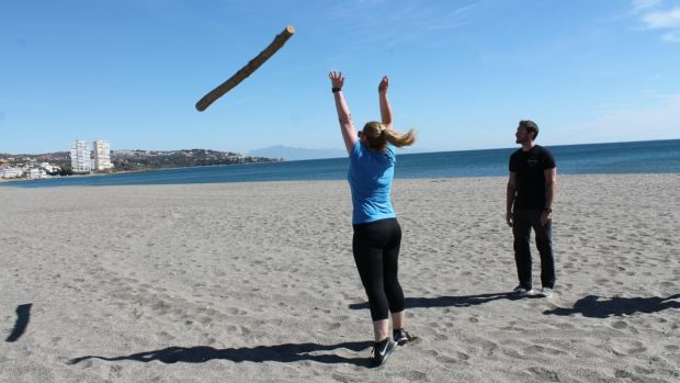 Rachel Flaherty throwing a pole on a beach in Sotogrande in Spain.