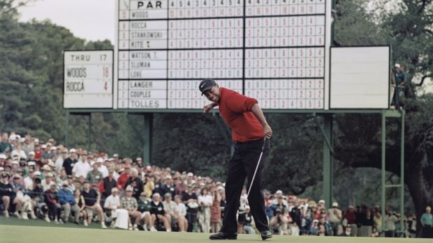 Tiger Woods celebrates after sinking a putt to win the Masters in 1997 in a record low score of 18 under par. Photograph: Stephen Munday/Allsport/Getty Images