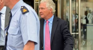 Former chairman  of Anglo Irish Bank Seán FitzPatrick leaving court in 2012. Mr FitzPatrick was accused of providing false information to Anglo Irish Bank auditors Ernst & Young, now EY, over his loans at the bank. Photograph: Eric Luke