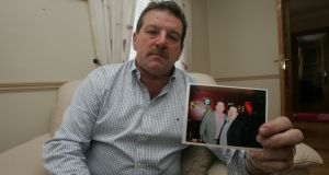 A file image of Steve Collins,  father of Roy Collins who was shot dead in Limerick ten years ago, pictured with a photograph of him with his son. Photograph: Press 22