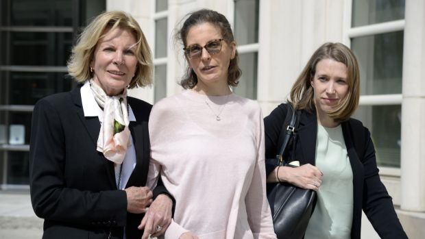 Clare Bronfman (centre), an heiress to the Seagram's liquor fortune, arrives at a Brooklyn court on Monday. Bronfman is one of the defendants in the sex-cult case. Photograph: Jefferson Siegel/The New York Times