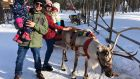 "Darragh Rogan, who lives in Helsinki, with  his wife Mirella and daughters Amelia (3) and Hanna (1) in the lap of the gods in Lapland. ""I'm regretting not writing it down, but I think the reindeer's name was Ari"""