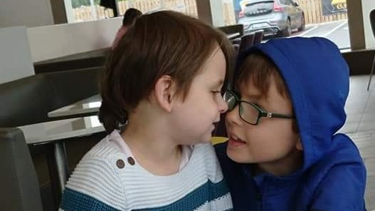 Twins Emmy and Max (6) have severe autism and are non-verbal.