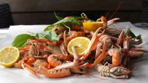 Poached Dublin Bay prawns with wild garlic butter
