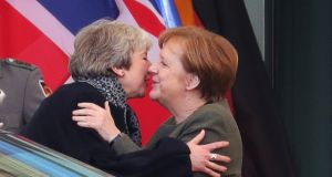 British prime minister Theresa May embraces chancellor Angela Merkel  in Berlin on Tuesday. Photograph:  Krisztian Bocsi/Bloomberg