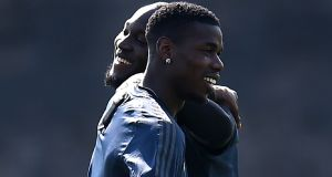 Paul Pogba and Romelu Lukaku warm-up during Manchester United's training session at  Carrington on Tuesday ahead of the Champions Cup quarter-final first leg against Barcelona at Old Trafford on Wednesday night. Photograph:    Oli Scarff/AFP/Getty Images