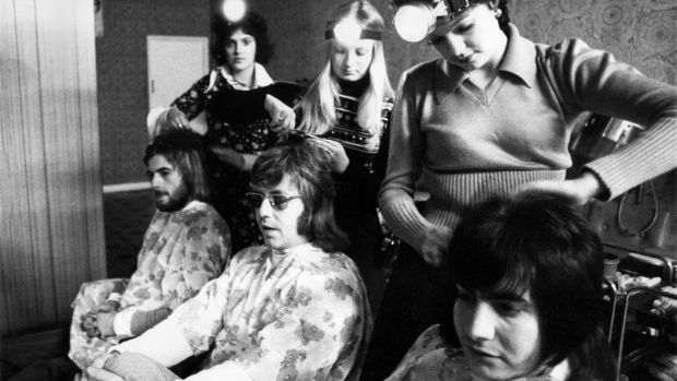 "In Chatham, Kent, a hairdressing saloon provided its assistants with battery-powered ""head-lamps"", similar to those used by miners due to electricity shortage in January 1974 Photograph: by WATFORD/Mirrorpix/Getty"