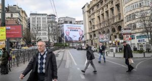 In Istanbul, billboards display huge photos of President Recep Tayyip Erdogan who, as the domestic economy has unravelled, has blamed external cultural and political forces. Photograph: Bulent Kilic/AFP/Getty Images