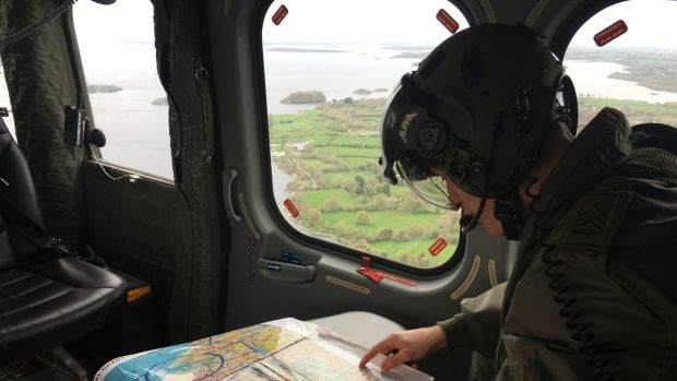 An Air Corps aviator plots a course for the EAS helicopter before it takes off from Athlone, Co Westmeath. Photograph: Peter Murtagh