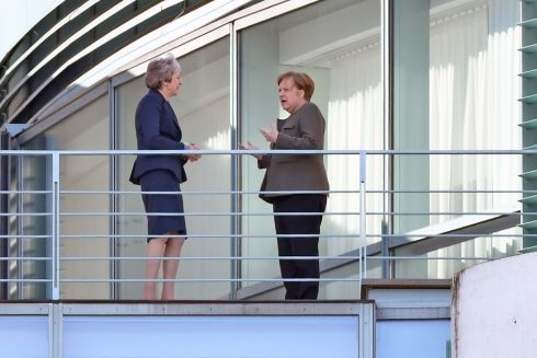 German chancellor Angela Merkel (R) and British prime minister Theresa May speak on the terace at the Chancellery in Berlin. Mrs May met with Dr Merkel to make her case for a short delay to the Brexit process. Photograph: John Macdougall/AFP/Getty Images