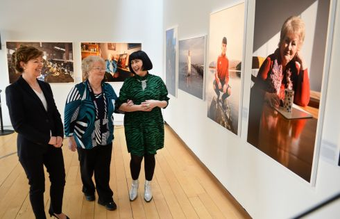 From left, Madeleine Clarke, founding director of Genio, Irene Dunne and Ruth Medjber, photographer, view a photograph of Ms Dunne at the launch of an exhibition, Facing Change, marking Genio's 10th anniversary. The not-for-profit group works with the State to reform social services. The exhibition features portraits taken by Ms Medjber, of ten inspirational people who have overcome challenges to contribute to their community. The exhibition is at the Gallery of Photography in Dublin from Wednesday April 10th to Sunday April 14th. Photograph: Dara Mac Donaill/The Irish Times