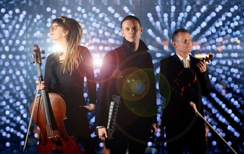 DJ Kormac with cellist Gabriele Dikciute and violinist Louis Roden of the Irish Chamber Orchestra at the launch of the Guinness Storehouse After Dark, a one-off performance on April 27th bringing together a group of Irish musicians to mark a milestone of welcoming 20 million visitors. Photograph: Julien Behal