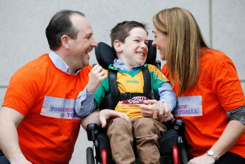 Tomás Mc Loughlin with his parents Shane and Ann Marie at the launch of their fundraising cycle, Croke to Croke Park. Photograph: Julien Behal