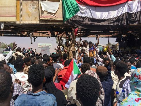 Uniformed Sudanese soldiers flash the victory sign at a demonstration near the military headquarters in the capital Khartoum. Activists behind anti-government protests say security forces have killed at least seven people, in an attempt to break up the sit-in outside the headquarters. Photograph: AP