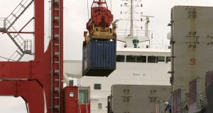 Ships in Dublin Port being loaded with goods for export. File photo. Photographer: Dara MacDonaill