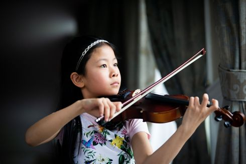 Shaochen Wu (9) from Dublin, winner of the junior violin competition. Photograph: Tom Honan