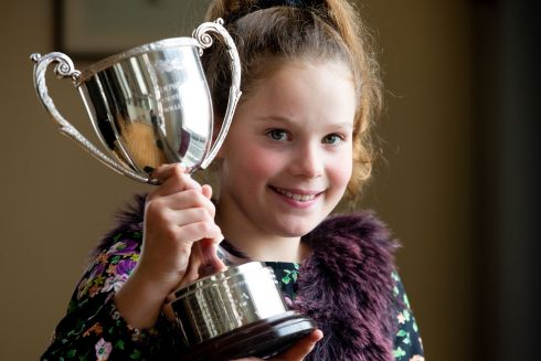 Winner of the junior flute competition, Grace Beatty (11) from Dublin, with the Maura Dowdall Cup. Photograph: Tom Honan