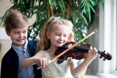 Charlotte Ryan (7) and her brother Peter Ryan (11)  before the start of the junior violin competition. Photograph: Tom Honan