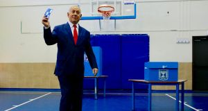 Israeli prime minister Binyamin Netanyahu casts his vote in Jerusalem. Photograph: Ariel Schalit/AFP/Getty