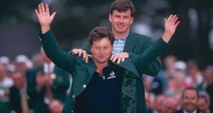 Nick Faldo places the Green Jacket onto Ian Woosnam in 1991. Photograph: Inpho/Getty