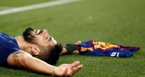 Luis Suarez after scoring against Atletico Madrid at the Camp Nou in Catalonia. Photograph: Getty Images
