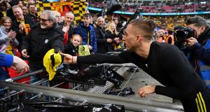 Gerard Deulofeu of Watford hands his shirt to a fan after the FA Cup semi-final at Wembley. Photograph: Dan Mullan/Getty Images
