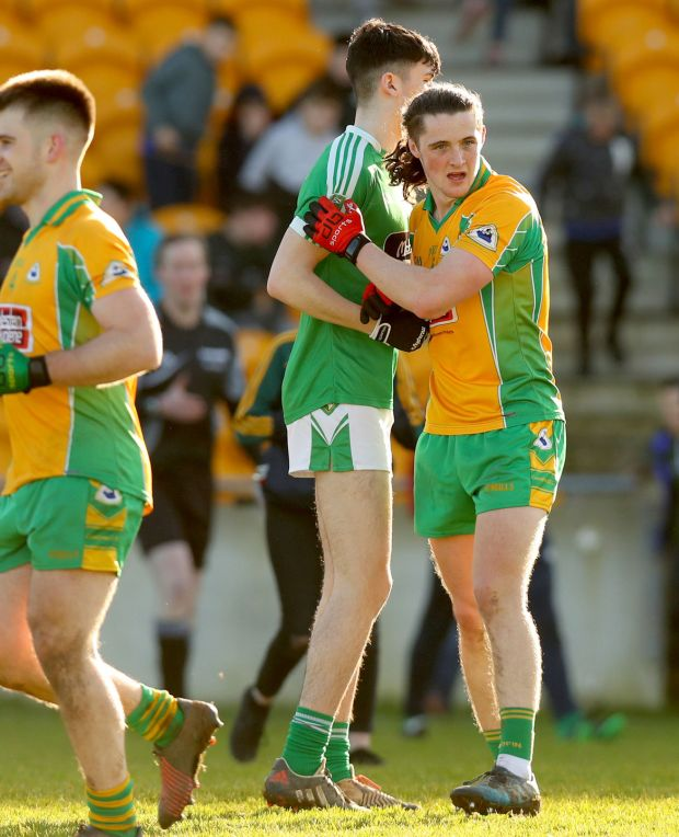 Moorefield's Adam Sweeney and Kieran Molloy of Corofin after the All-Ireland Senior Football Club Championship semi-final. Photograph: James Crombie/Inpho
