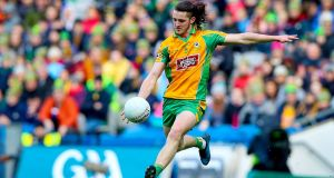 Corofin's Kieran Molloy in action against Dr Crokes. Photograph: Tommy Dickson/Inpho