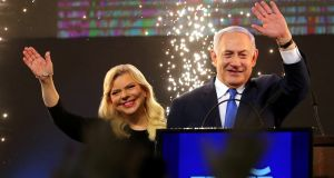 Israeli prime minister Binyamin Netanyahu and his wife Sara celebrate following the announcement of exit polls in Israel's parliamentary election in Tel Aviv  on Tuesday night. Photograph: Ammar Awad/Reuters