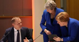 Britain's prime minister Theresa May and Germany's chancellor Angela Merkel in discussion with European Council president Donald Tusk, ahead of the meeting at the European Parliament in Brussels, Belgium. Photograph: Kenzo Tribouillard/Pool via Reuters