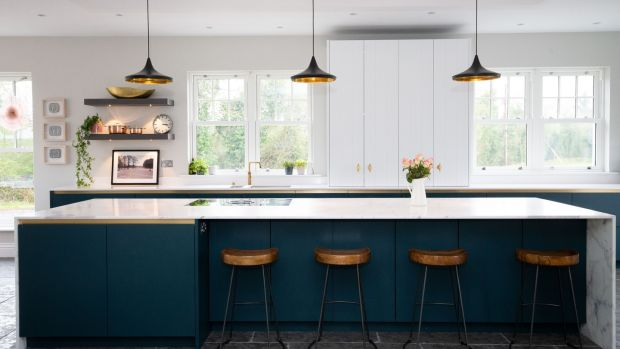 The kitchen has lots of prep space and under-counter storage, while the sink and a wall of low cabinets runs parallel to optimise the work triangle. Photograph: Tom Honan