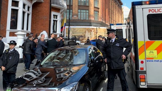 Police carry Julian Assange from the Ecuadorian embassy in London after he was arrested by police officers and taken into custody following the Ecuadorian government's withdrawal of asylum. Photograph: PA