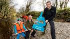 Gus O'Reilly (aged 6), from Navan, Co Meath, with Dr Paddy Gargan and Dr Cathal Gallagher of Inland Fisheries Ireland, at the launch of new National Salmon Scale Project.  Photograph: Andres Poveda