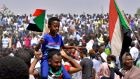 Sudanese protesters  celebrate in Khartoum after Omar al-Bashir was ousted from power on Thursday. Photograph: Reuters