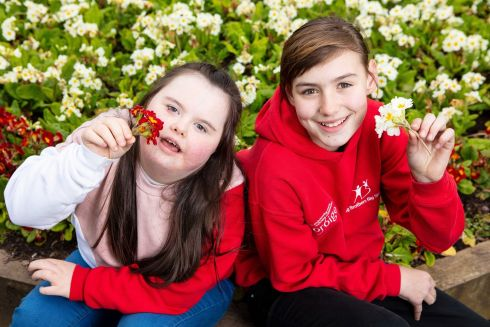 FLOWER POWER: Grace O'Brien (12) and Katelyn Harrington (11), from Cork, pictured at Ballyphehane Park as part of the Aldi Foróige Youth Citizenship Awards. Photograph: Michael O'Sullivan/OSM Photo